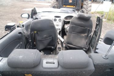 Seat back distortion caused by rear passengers not wearing seat belts at the time of a violent impact