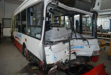 School bus in which the seats partly tore away from the floor in a crash