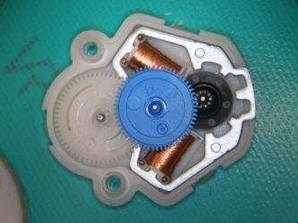 A stepper motor (opened) from a speedometer