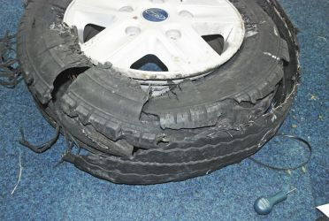 Reassembled tread placed against the carcass