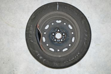 Typical violent impact damage where the inflated tyre cushioned the impact