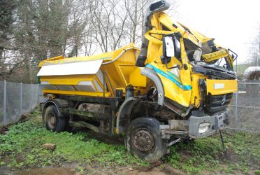 Gritter lorry equipped with 'summer' tyres slid off the road whilst gritting